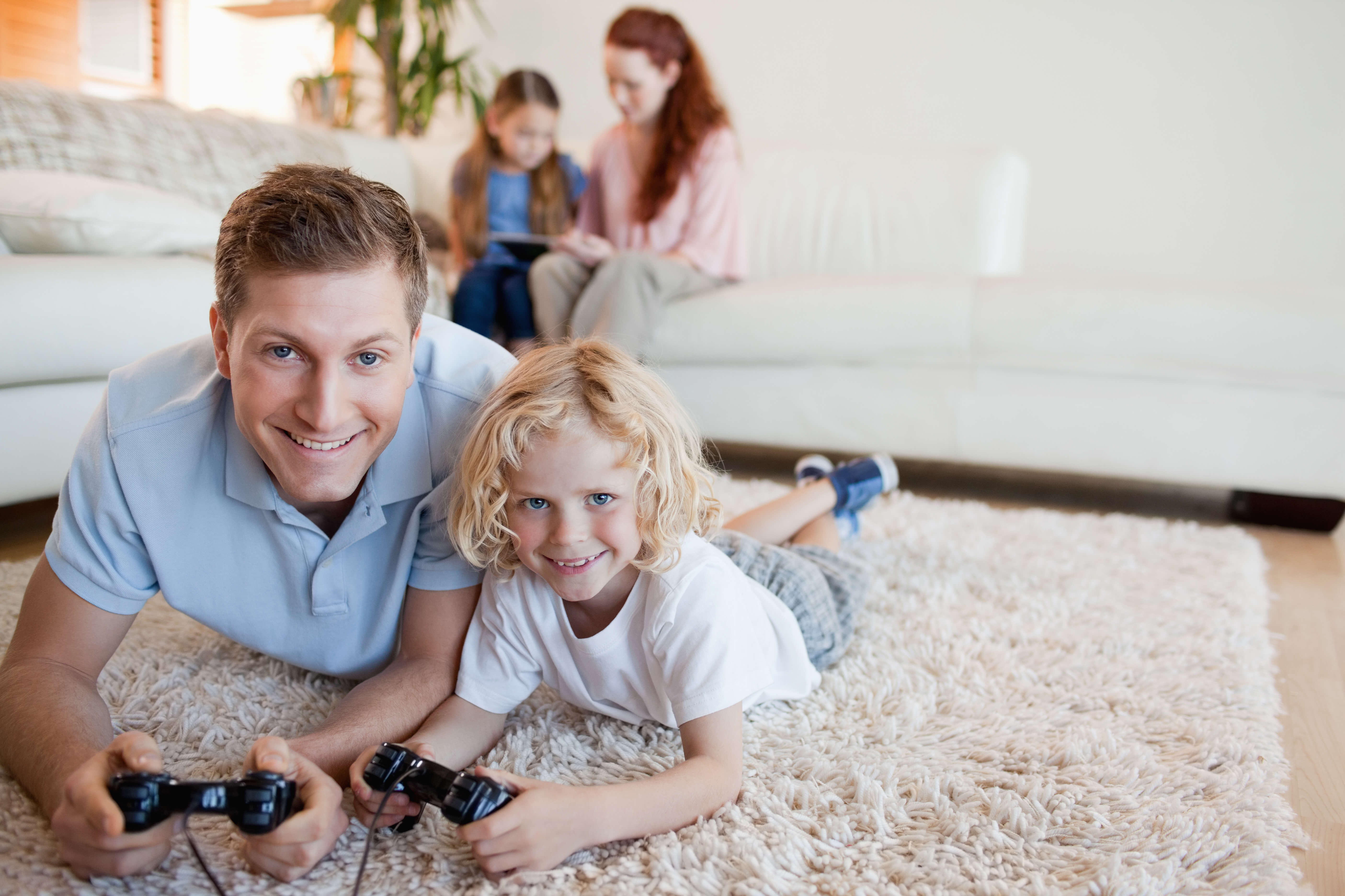 family playing on protected clean carpet in harrah ok